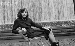 ca. 1970 --- American Writer Patricia Highsmith in Front of Fountain --- Image by © Alex Gotfryd/CORBIS